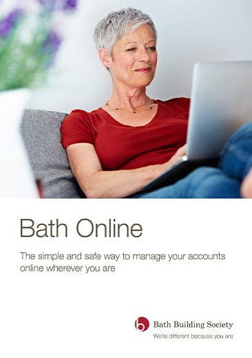 Image of front cover of Bath Online publication by Bath Building Society including logo. image of woman sat on sofa using laptop