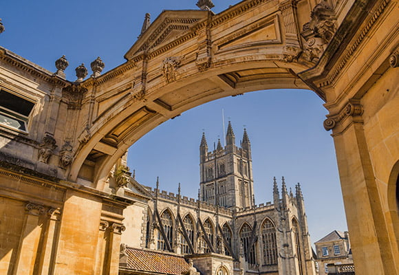 Palladian Archway in Bath City centre with Abbey in the background