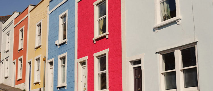 Landscape image of row of multicoloured terraced residential houses